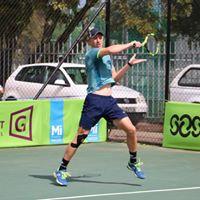 Tennis player hitting the ball at 2018 Curro Junior ITF 2 Semi-Finals