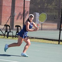 Tennis player going for the ball at 2018 Curro Junior ITF 2 Girls in Action