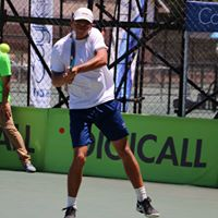 Tennis player hitting the ball at Digicall Futures 2 Finals
