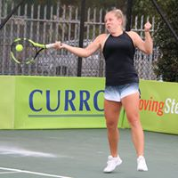 Tennis player hitting the ball at Digicall Futures 2 Semi-finals