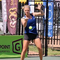 Tennis player hitting the ball at 2018 Digicall Futures 1 Finals with Prize Giving