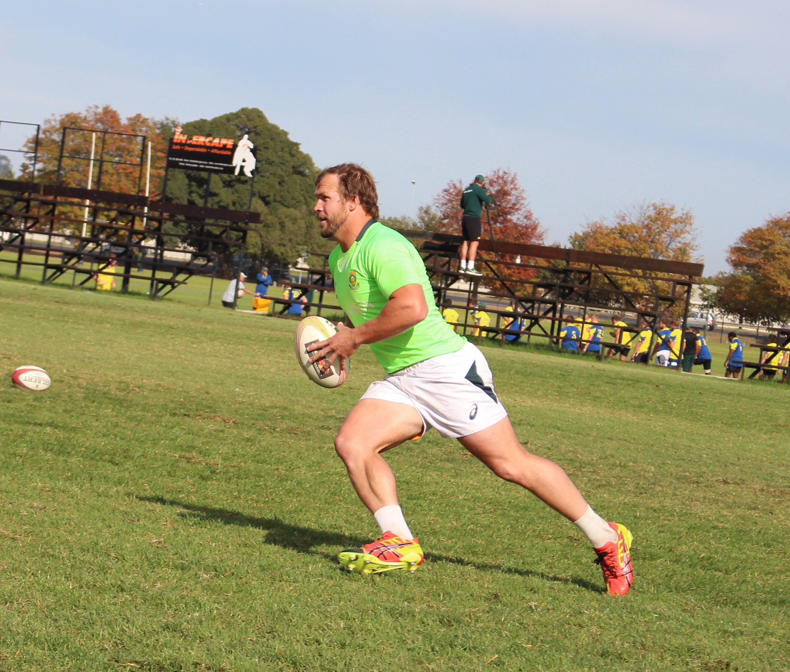 Frankie Horne running on the rugby field